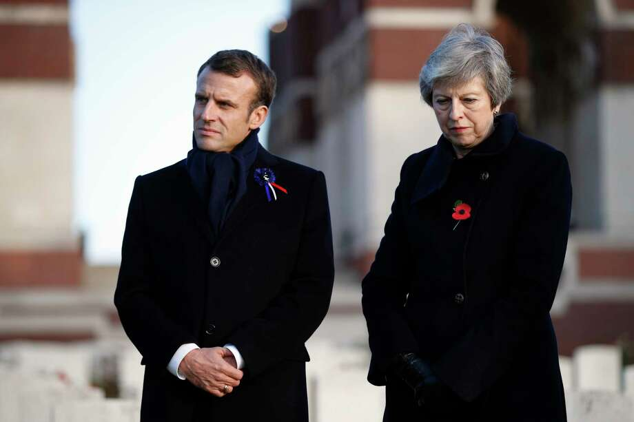 FILE - In this  Nov. 9, 2018 file photo, French President Emmanuel Macron, left, and British Prime Minister Theresa May visit the Thiepval Memorial, in Thiepval, northern France. EU leaders will confront British Prime Minister Theresa May for the second time in three weeks on her government?s plans at an emergency Brexit summit on Wednesday, April 10, 2019, and such gatherings aren?t getting any friendlier.  (AP Photo/Francois Mori, Pool, File) Photo: Francois Mori / Copyright 2018 The Associated Press. All rights reserved.