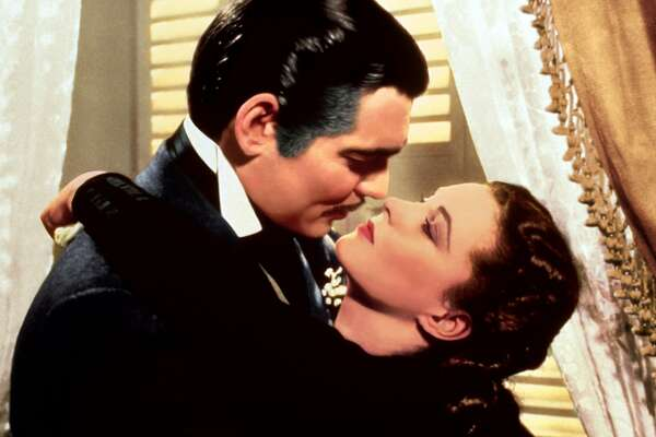 """This image released by Turner Classic Movies shows Clark Gable, left, and Vivien Leigh in a scene from """"Gone with the Wind."""" On Thursday, the TCM Classic Film Festival will open its 10th annual edition in Los Angeles with """"When Harry Met Sally..."""" To mark its anniversary, TCM will on Sunday again air """"Gone With the Wind,"""" the film that it first transmitted on April 14, 1994. (Turner Classic Movies via AP)"""