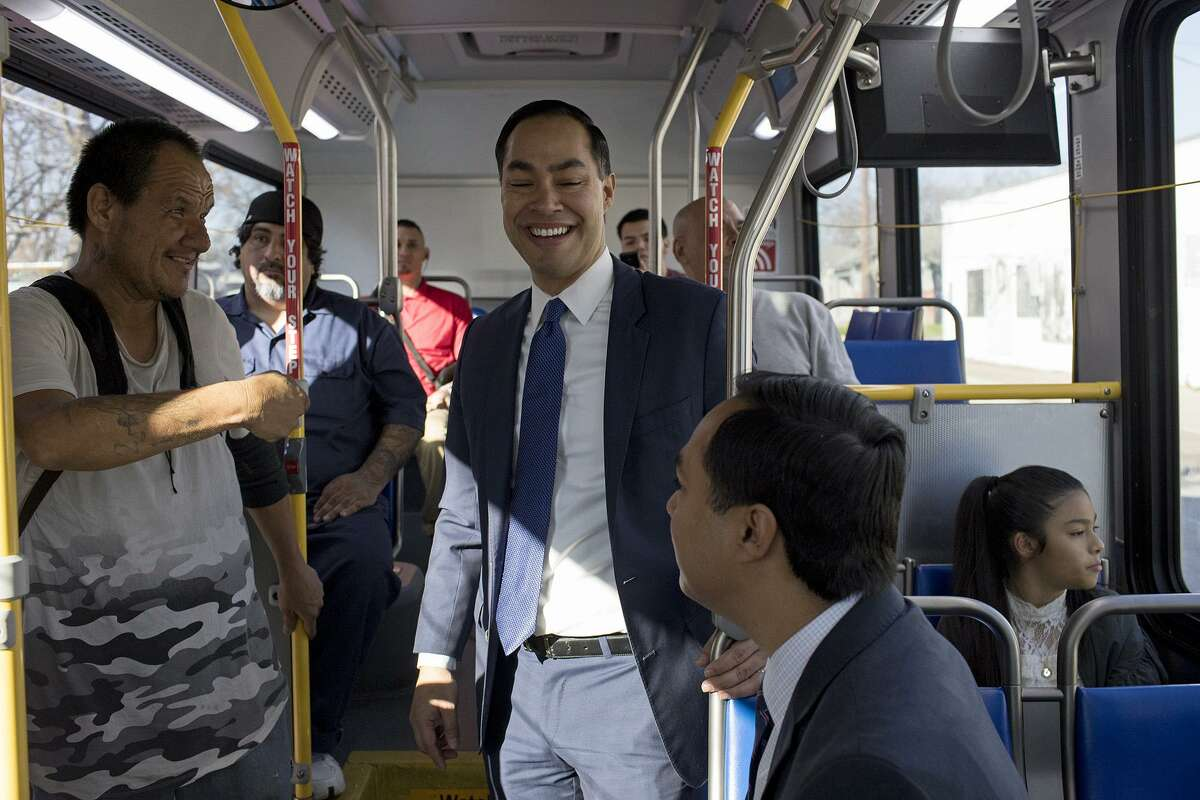 Juli‡n Castro, former HUD Secretary and former mayor of San Antonio, center, his twin brother, Congressman Joaqu'n Castro, and Juli‡n's daughter, Carina, 9, ride the 68 bus to Guadalupe Plaza, a bus route they rode as children, to announce Juli‡n's campaign for President of the United States in San Antonio on Saturday, Jan. 12, 2019.