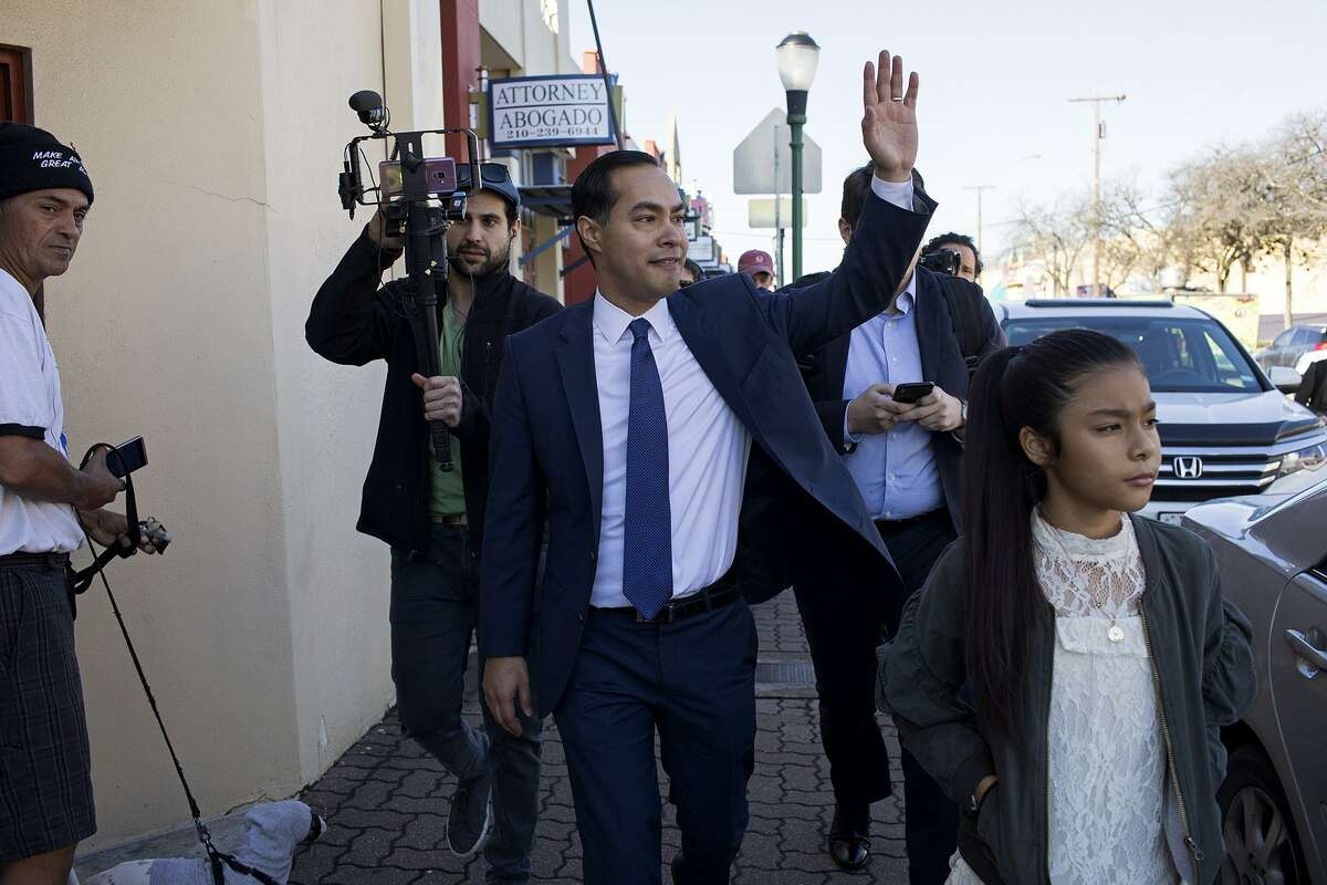 Upon his arrival by a city bus, Juli‡n Castro, former HUD Secretary and former mayor of San Antonio, with his daughter, Carina, 9, waves to a line of supporters waiting to enter Plaza Guadalupe to hear him announce his run for President of the United States at Plaza Guadalupe in San Antonio on Saturday, Jan. 12, 2019.