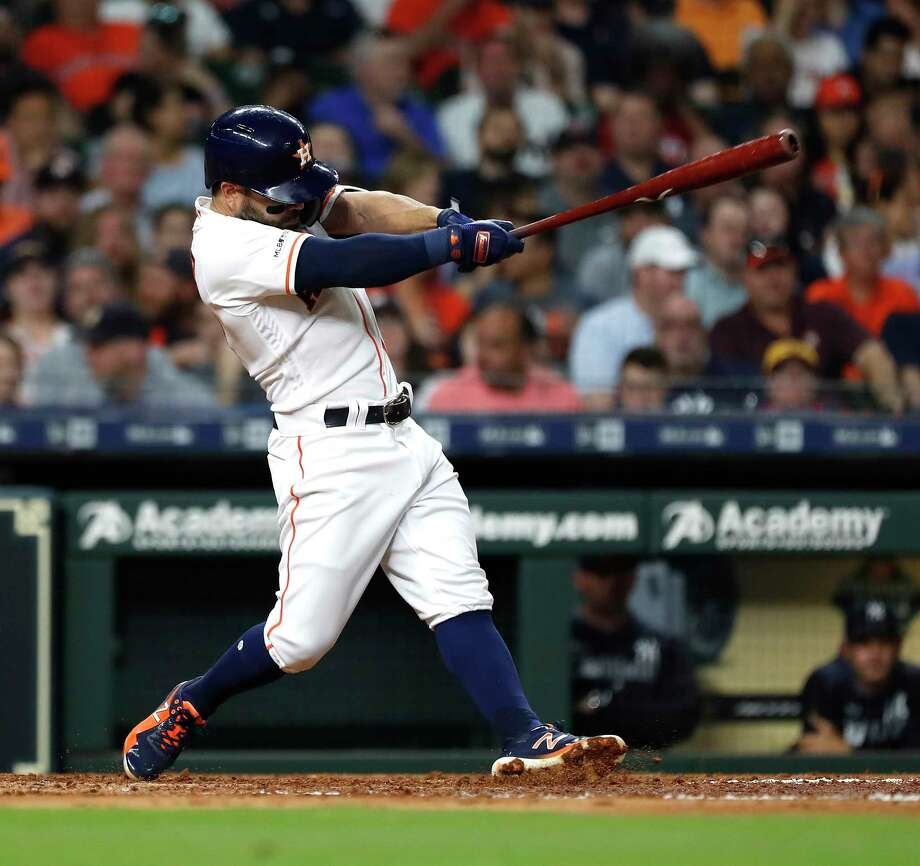 Houston Astros second baseman Jose Altuve (27) hits his 100th career home run during the third inning of an MLB game at Minute Maid Park, Tuesday, April 9, 2019, in Houston. Photo: Karen Warren, Staff Photographer / © 2019 Houston Chronicle