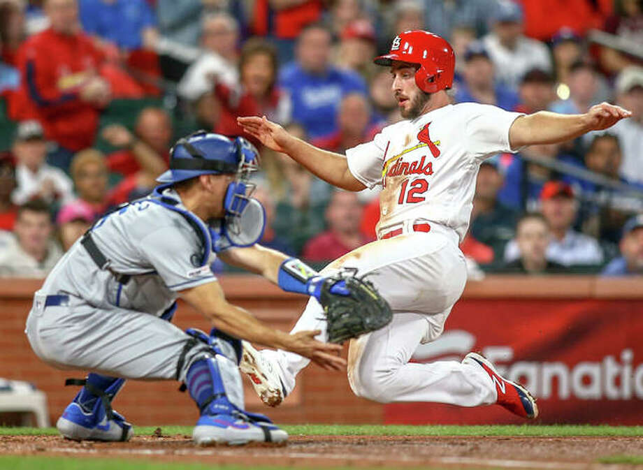 Cardinals' Paul DeJong (right) slides home to score before Dodgers catcher Austin Barnes can apply a tage during the third inning Tuesday night at Busch Stadium. Photo: Scott Kane / Associated Press