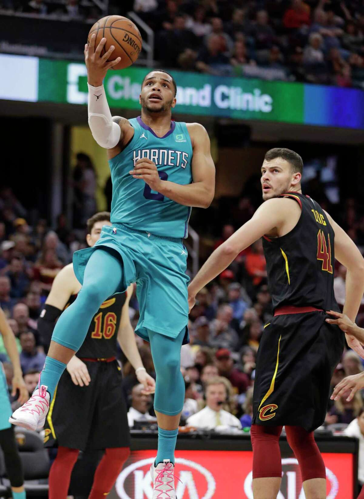 Charlotte Hornets' Miles Bridges, left, drives to the basket against Cleveland Cavaliers' Ante Zizic in the second half of an NBA basketball game, Tuesday, April 9, 2019, in Cleveland. Charlotte won 124-97. (AP Photo/Tony Dejak)
