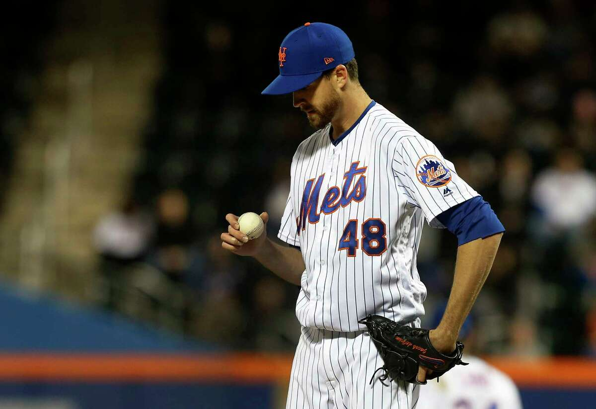 NEW YORK, NEW YORK - APRIL 09: Jacob deGrom #48 of the New York Mets looks at the ball as he stands on the mound during the third inning against the Minnesota Twins at Citi Field on April 09, 2019 in the Flushing neighborhood of the Queens borough of New York City. (Photo by Jim McIsaac/Getty Images)