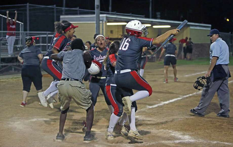 Judson's bench goes wild after Melissa Gonzalez slams a two-run homer in the bottom of the seventh inning to give the Rockets a walkoff victory in Tuesdat night's District 26-6A clash with Smithson Valley. Photo: Ronald Cortes /Contributor / / 2019 Ronald Cortes