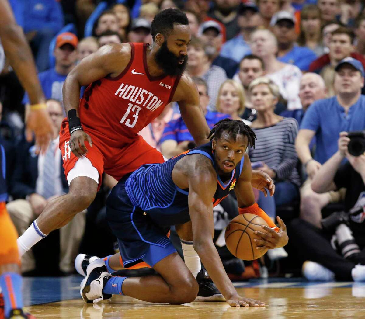 Oklahoma City Thunder forward Jerami Grant, right, grabs the ball in front of Houston Rockets guard James Harden (13) during the first half of an NBA basketball game Tuesday, April 9, 2019, in Oklahoma City. (AP Photo/Sue Ogrocki)