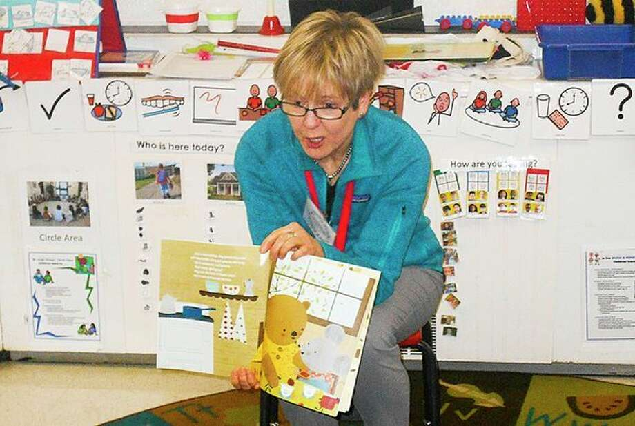 Diane Stevens, a member of the Midland Kiwassee Kiwanis, reads toHead Start children at Longview Elementary Early Childhood Center recently from a book gifted to them. Kiwanis members have committed to read to Midland County classrooms each month to support a mission to close the achievement gap for children. (Submitted photo/Mavis McDaniel)