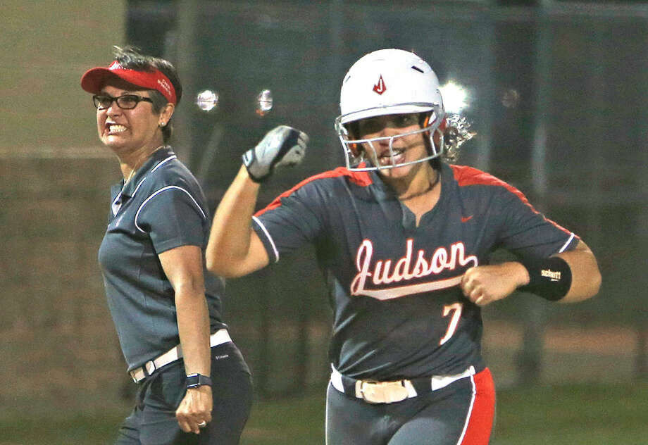 Judson's Melissa Gonzalez slams a two run HR to win the game as she celebrates with head coach Theresa Urbanovsky from District 26-6A high school softball game betwen Judson and Smithson Valley on Tuesday April 9 , 2019. Photo: Ronald Cortes