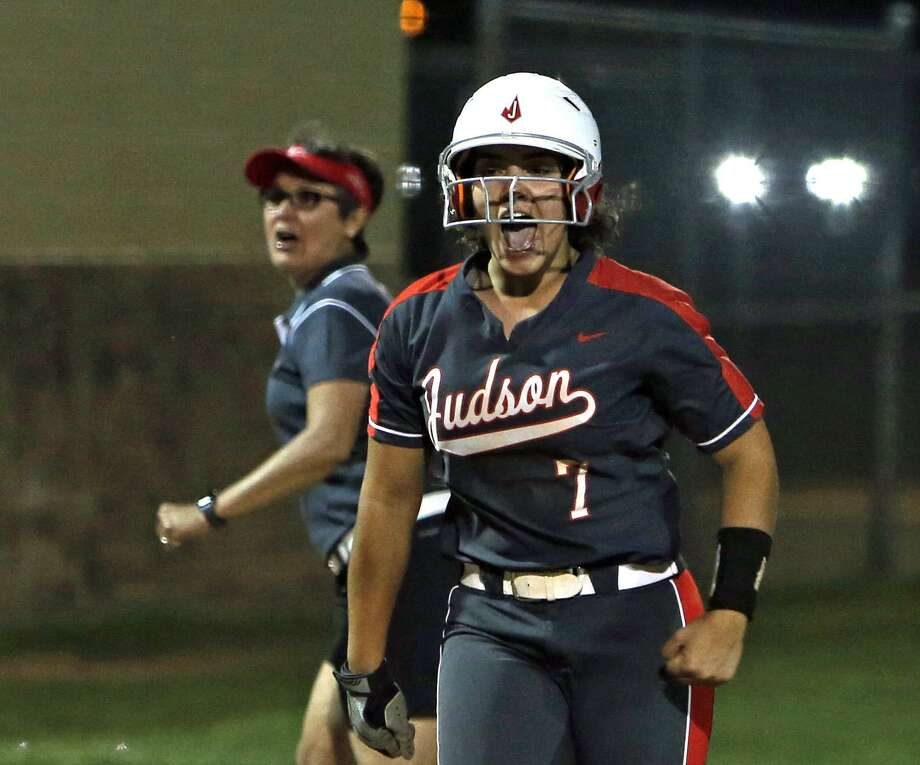 Judson's Melissa Gonzalez triumphantly rounds the bases after hitting a game-winning, two-run homer in the seventh inning as head coach Theresa Urbanovsky looks on. Photo: Ronald Cortes /Contributor / / 2019 Ronald Cortes