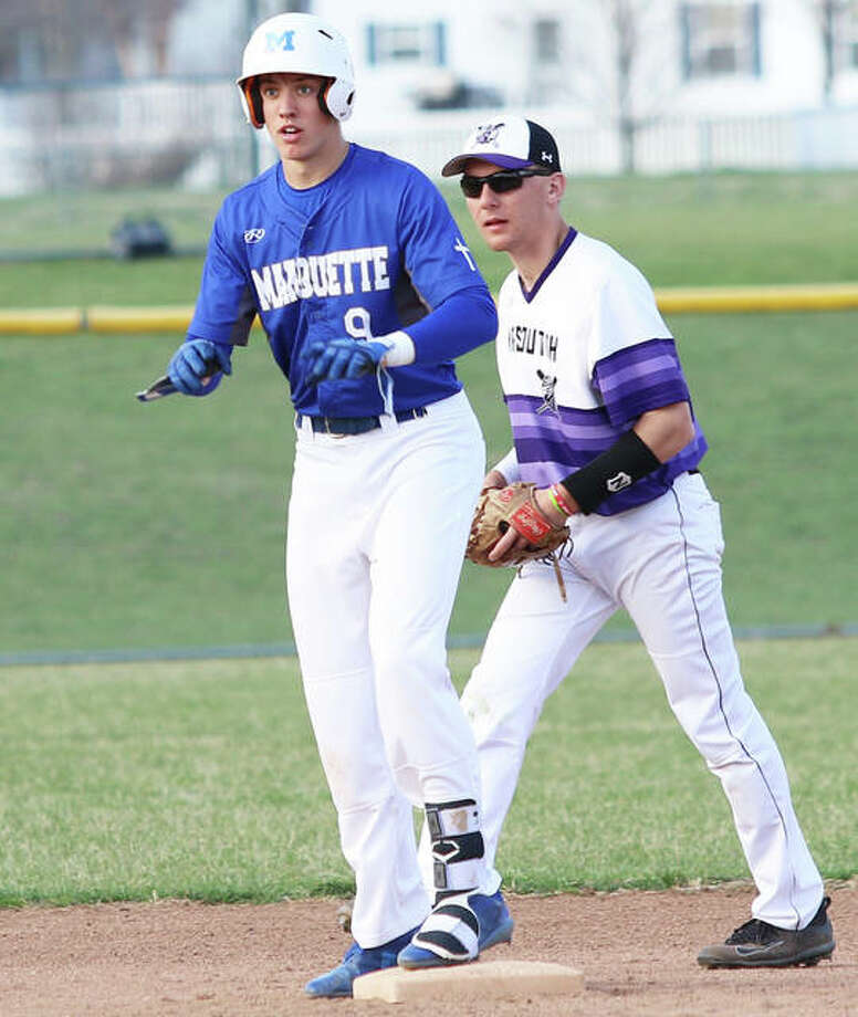Marquette Catholic's Garrett Weiner (left) looks back to the Explorers dugout after hitting a double last week at Mascoutah. Weiner had two hits Tuesday to help Marquette rally for a 6-5 10-inning win over Civic Memorial in Alton. Photo: Greg Shashack / The Telegraph