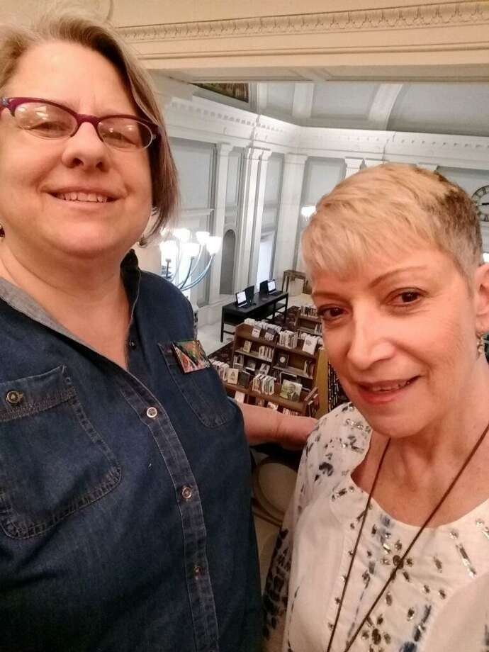 Celebrating New Haven Public Library Workers: Lore Lichtenberg (AFSCME Local 884), Library Technical Assistant, and Maria Tonelli (AFSCME Local 3144), Manager of Collection Management and Circulation Services. Photo: Larry Dorman /