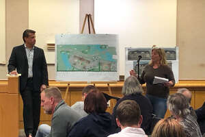 Dana McLeod-Small, a Rustyville Road resident who started a petition to protest the Radtke farm rezoning, speaks at the Planning Board meeting next to Joe Zappone, the developer representing the property owner at Colonie Public Operations Center on April 9, 2019.