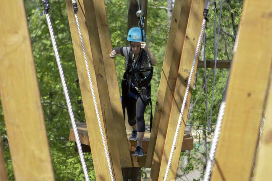 The Villager reporter Jane Stueckemann walks through a swinging pathway Tuesday, April 9, 2019 at Texas TreeVentures in The Woodlands. Photo: Cody Bahn, Houston Chronicle / Staff Photographer / © 2018 Houston Chronicle