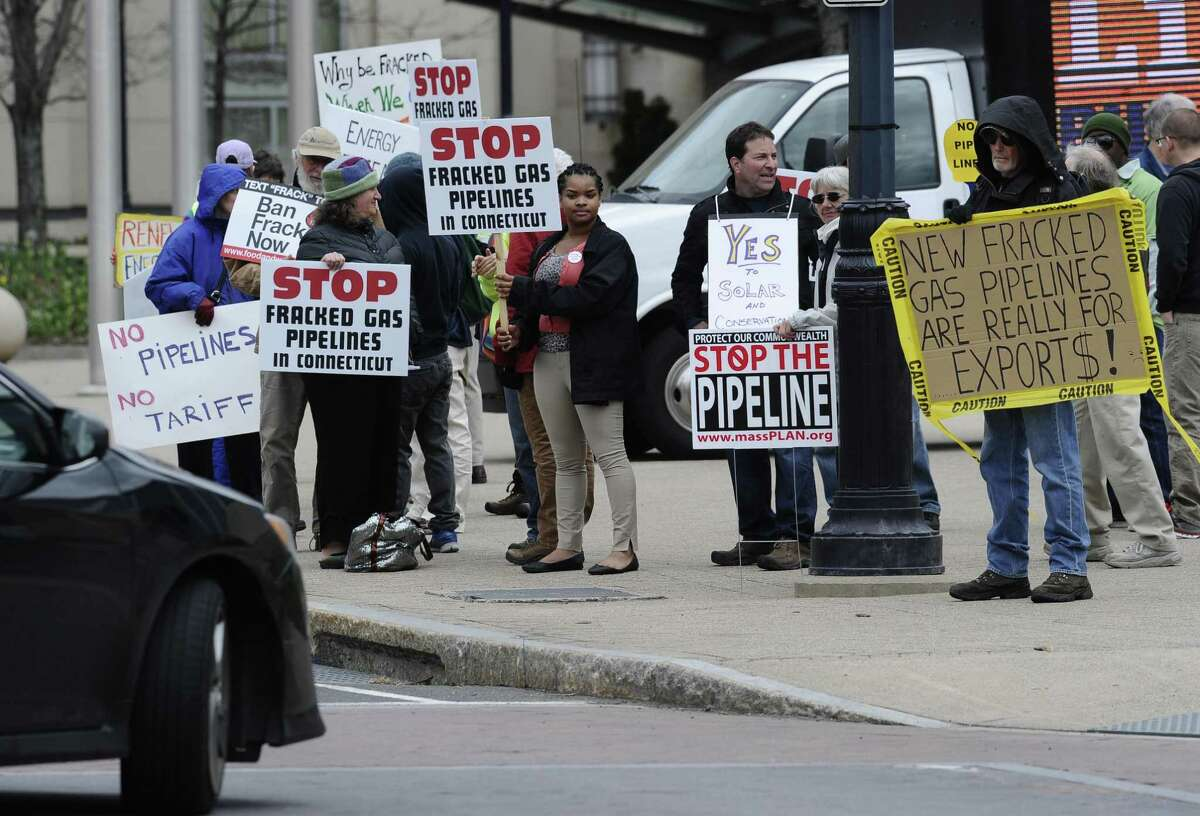 A group of protesters gather outside the Connecticut Convention Center in Hartford in 2015 as New England's governors met to update their long-term energy strategy that increasingly relies on natural gas and efforts to build more pipelines.