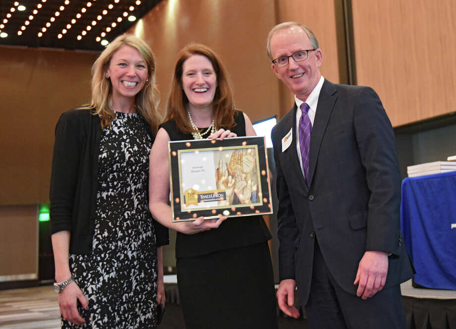 Times Union's Tom Eason, right, presented Brittany MacCrea, left, and Janet Silver of Hinman Straub P.C. an award during the Annual Top Workplaces event at the Albany Capital Center on Tuesday April 9, 2019 in Albany, N.Y. (Lori Van Buren/Times Union) Photo: Lori Van Buren, Albany Times Union / 20046647A
