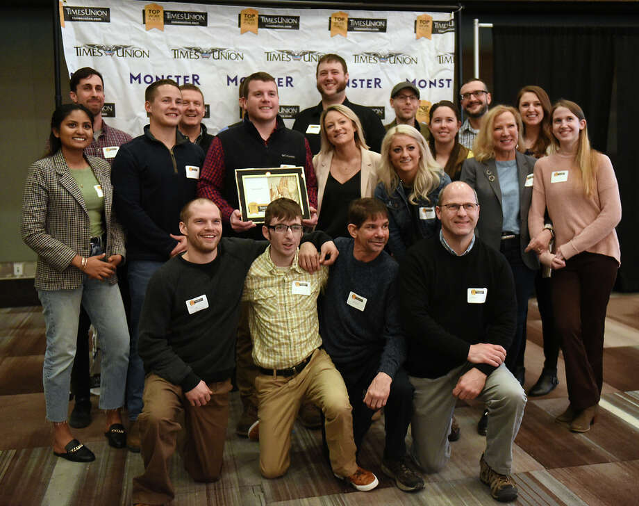 Employees from Tierra Farm stand with their award in the best small companies category during the Annual Top Workplaces event at the Albany Capital Center on Tuesday April 9, 2019 in Albany, N.Y. (Lori Van Buren/Times Union) Photo: Lori Van Buren, Albany Times Union / 20046647A
