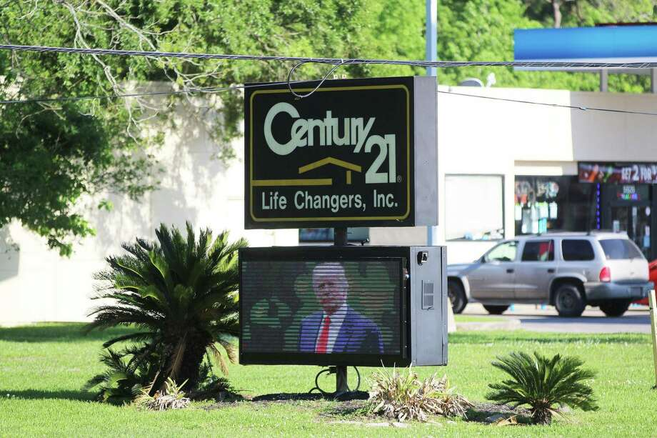This familiar Century 21 sign sports a Welcome to Crosby, Mr. President announcement and a photo of the POTUS on FM 2100 near South Diamondhead. President Trump is expected to be in the Crosby area on Wednesday afternoon. Photo: David Taylor / Staff Photo