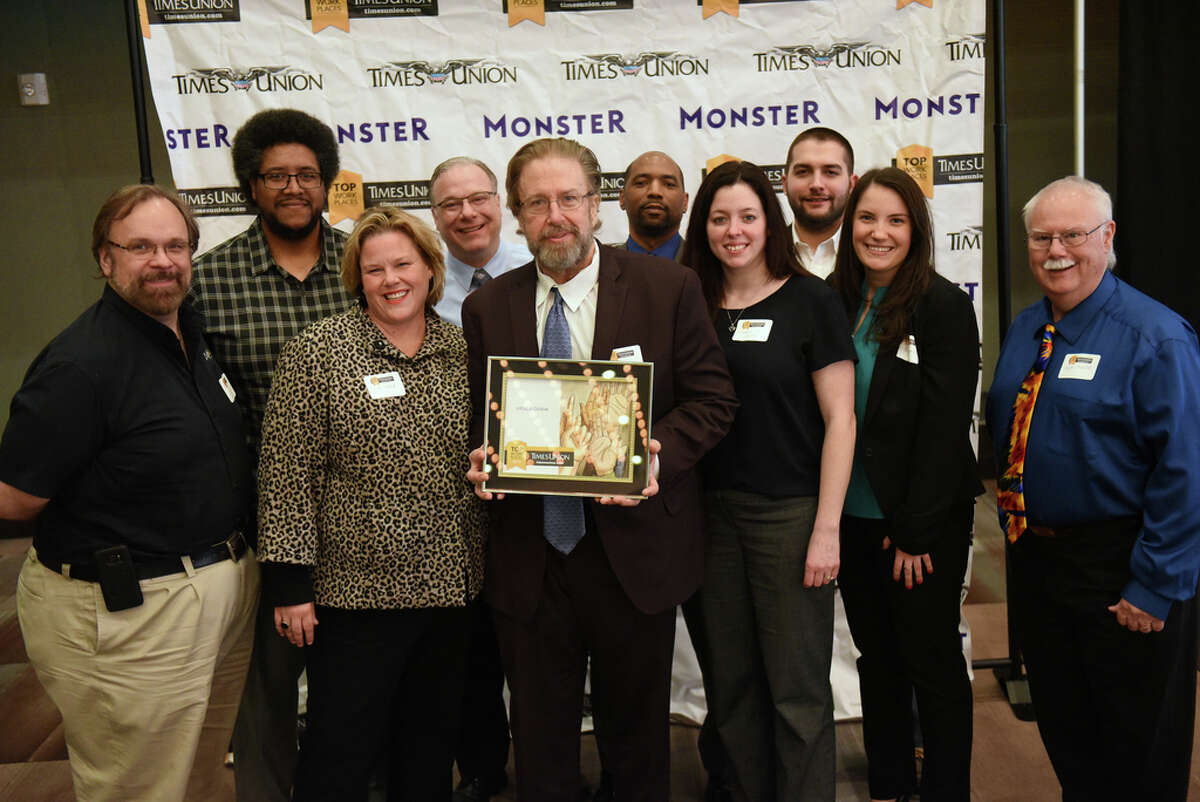 Employees from InfoEd Global stand with their award during the Annual Top Workplaces event at the Albany Capital Center on Tuesday April 9, 2019 in Albany, N.Y. (Lori Van Buren/Times Union)