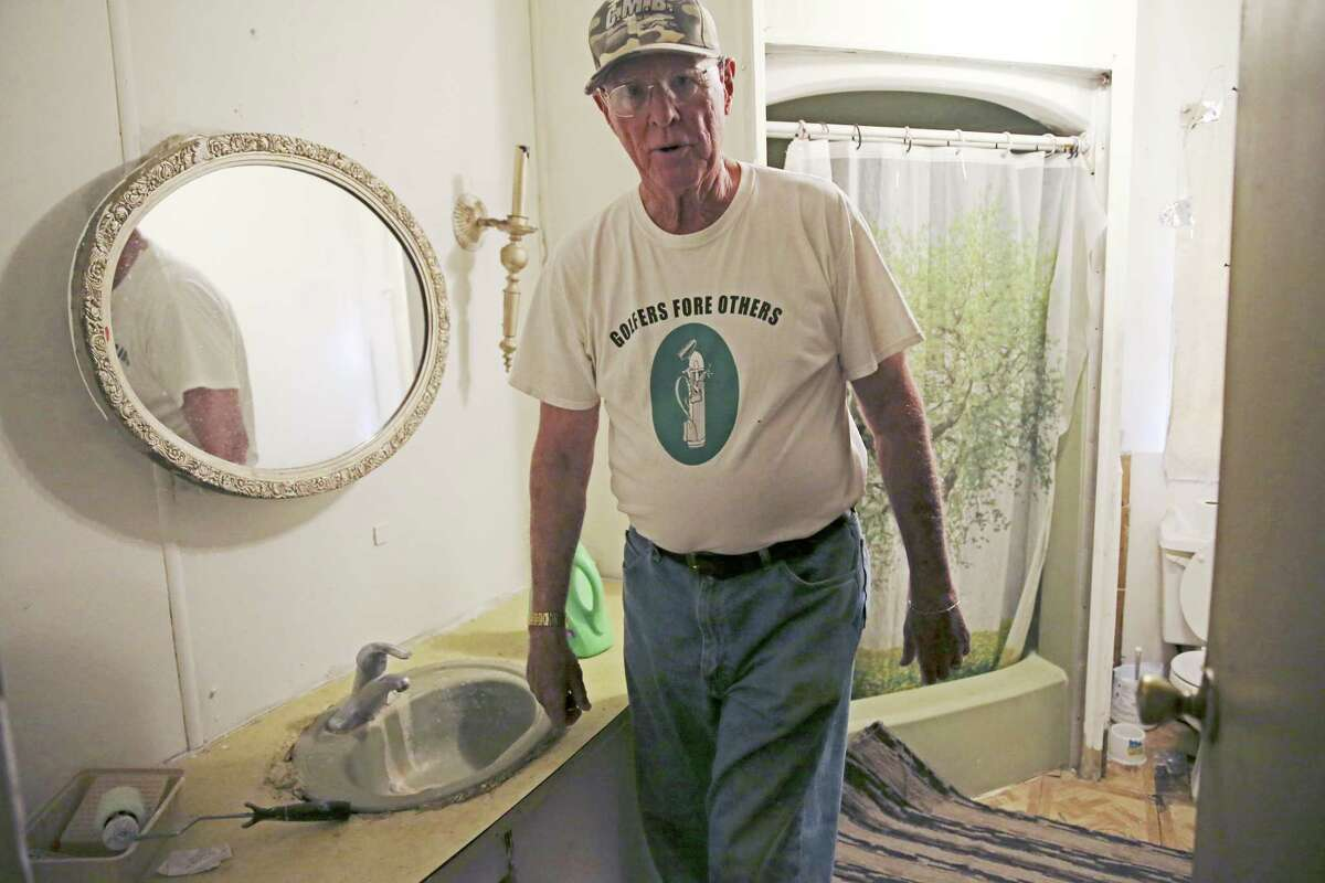 Fred Martin, founder of Golfers Fore Others, checks out a bathroom scheduled for repairs at a mobile home in the Shady Rest Mobile Home Park in the outskirts of Boerne. Made up of retirees, the group helps rebuild homes for the needy.