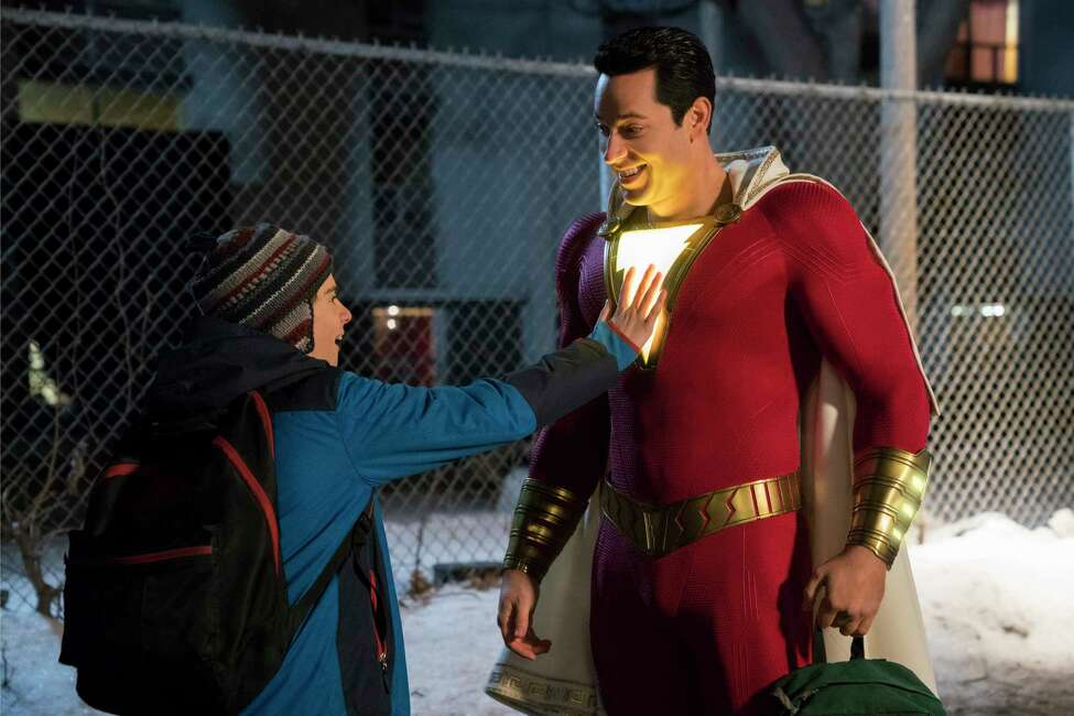 """This image released by Warner Bros. shows Zachary Levi, right, and Jack Dylan Grazer in a scene from """"Shazam!"""" (Steve Wilkie/Warner Bros. Entertainment via AP)"""