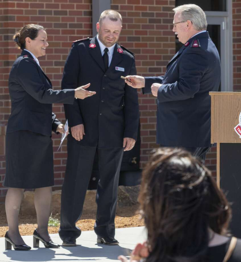 Lt. Col. Ronnie Raymer, Texas Divisional Commander with Salvation Army, talks about and presents the keys to the building to Captain Michelle Walker and her husband Captain Jeremy Walker for the new Salvation Army building. 04/10/19 Tim Fischer/Reporter-Telegram Photo: Tim Fischer/Midland Reporter-Telegram