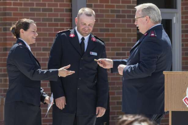 Lt. Col. Ronnie Raymer, Texas Divisional Commander with Salvation Army, talks about and presents the keys to the building to Captain Michelle Walker and her husband Captain Jeremy Walker for the new Salvation Army building. 04/10/19 Tim Fischer/Reporter-Telegram