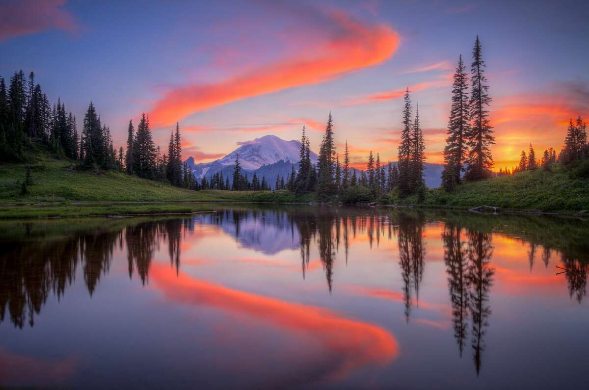 It's not a gallery of Mount Rainier National Park without pictures of the eponymous mountain reflected in the clear waters of a nearby lake right? Tipsoo Lake provides a perfect canvas here for a myriad of colors to create a symmetrical beauty.