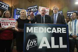 Sen. Bernie Sanders, I-Vt., joined by, Sen . Kirsten Gillibrand, D-N.Y. front left, and Sen. Jeff Merkley, D-Ore., front right, introduces the Medicare for All Act of 2019, on Capitol Hill in Washington, Wednesday, April 10, 2019. (AP Photo/Manuel Balce Ceneta)