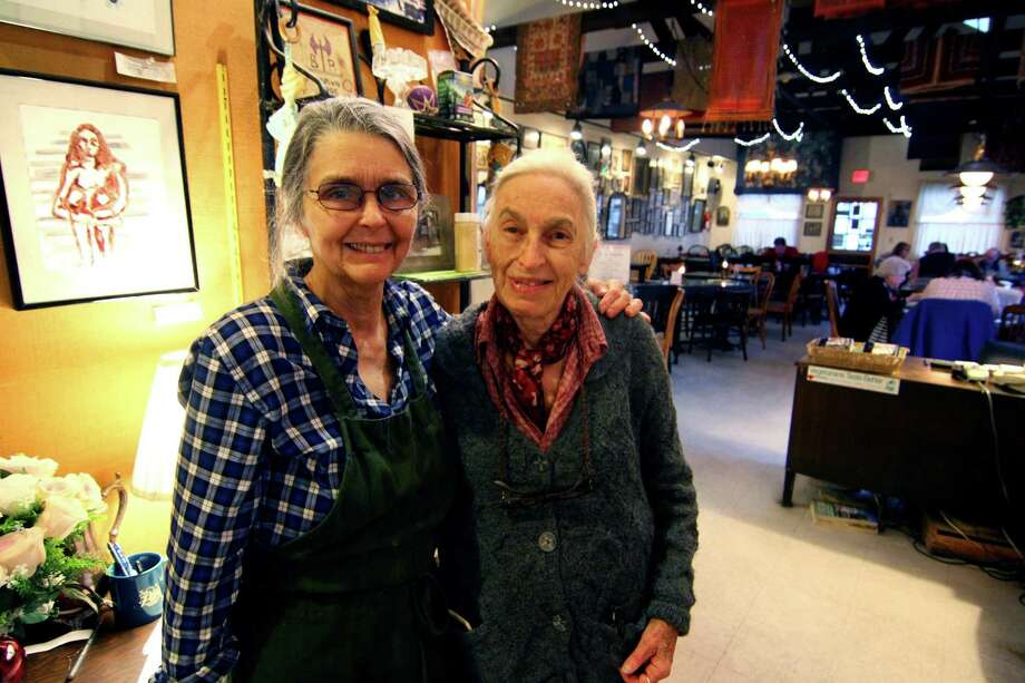 Business partners and friends, Noel Furie, left, and Selma Miriam, who own and operate Bloodroot vegetarian reastaurant, pose at the restaurant in Bridgeport, Conn., on Friday, Apr. 5, 2019. The landmark vegetarian restaurant and feminist bookstore, which opened in 1977, will be featured in a new documentary that will debut at the San Francisco International Film Festival next week. Photo: Christian Abraham / Hearst Connecticut Media / Connecticut Post
