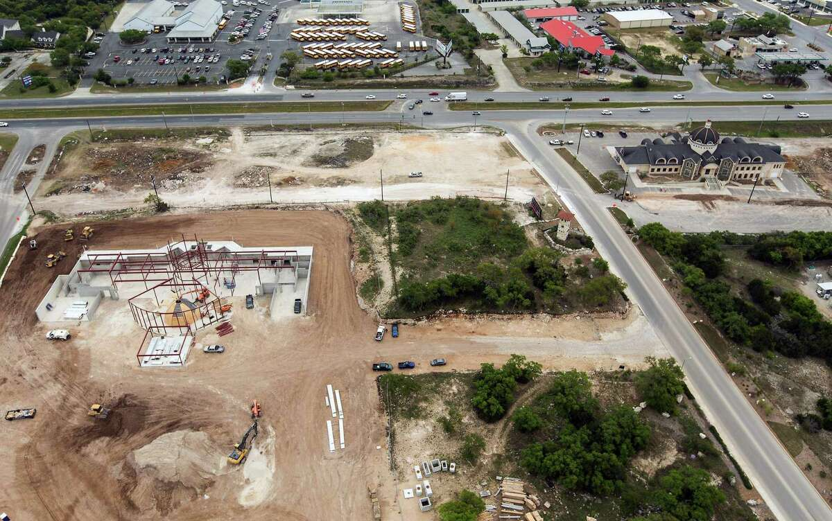 The original Mission Park Funeral Chapels Stone Oak, upper right, as pictured on April 3, next to a replacement building under construction. The original funeral home and surrounding land were sold to the state of Texas two years ago for the widening of U.S. 281.
