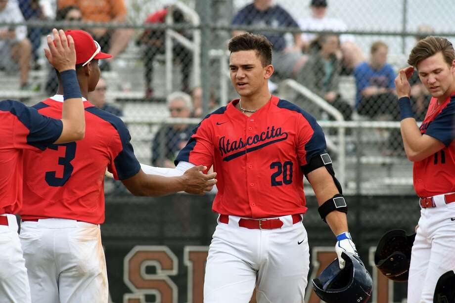 Atascocita junior catcher Tyler Byrd (20) is greeted by teammate Brice Matthews (3) after his homerun against Bridgeland in the first inning of their matchup in the FBISD Varsity Tournament at Travis High School on March 9, 2019. Photo: Jerry Baker, Houston Chronicle / Contributor / Houston Chronicle
