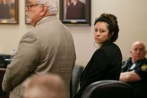 Laura Messick-Flores, right, appears with defense attorney Ed Garza in the 175th state District Court, Cadena-Reeves Justice Center on Wednesday, April 10, 2019. Messick-Flores is accused of brutally shooting and stabbing her boyfriend, Chason Montez DeOca, who was an Iraq War veteran, on June 10, 2017.