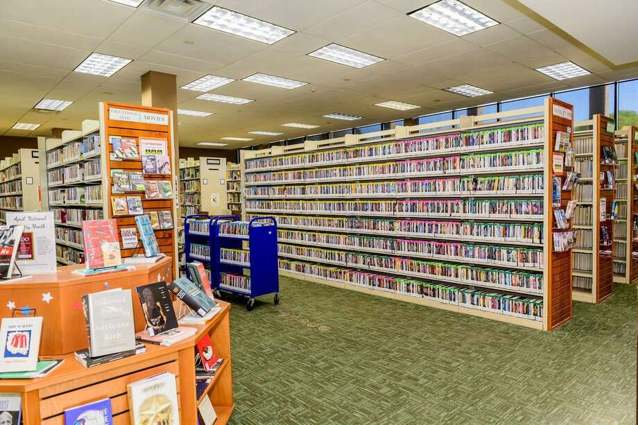 Shelves are crowded with items at the Helen Hall Library in League City. The city is studying what to do to meet increasing demand at the facility spurred by community growth.