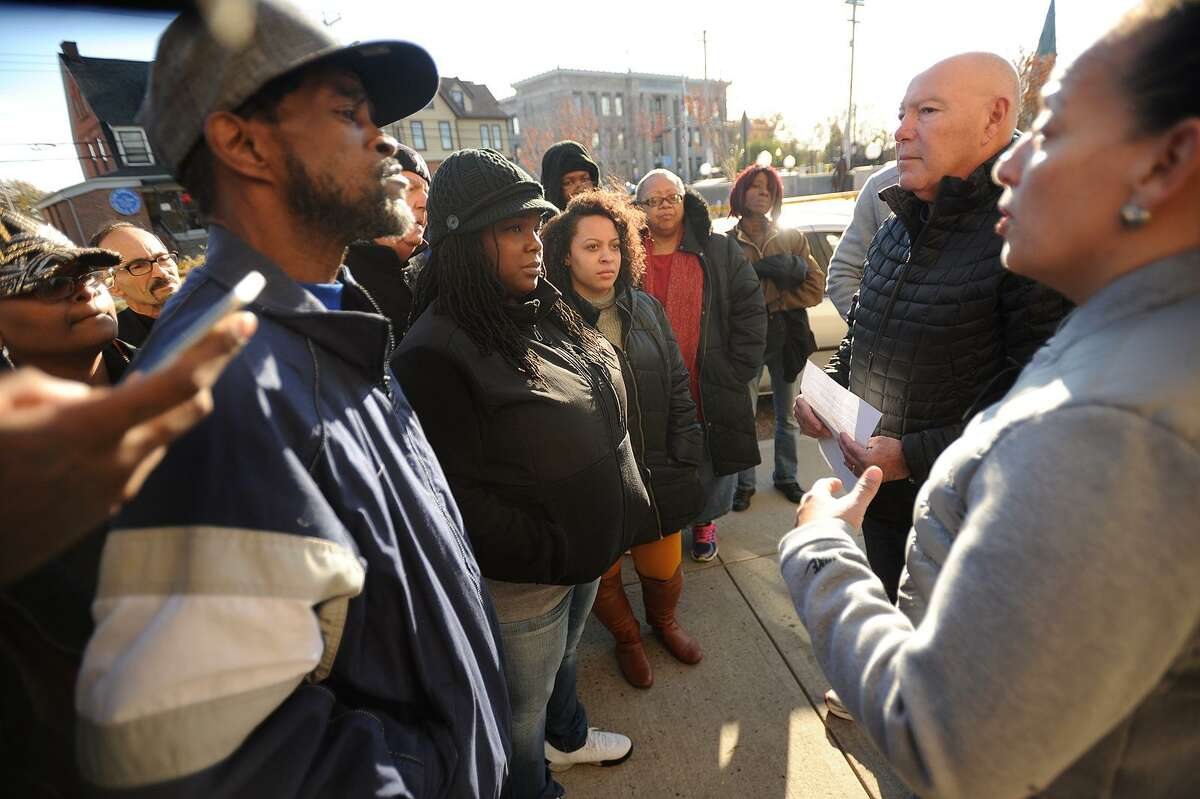 Bridgeport City Council members Ernest Newton, left, and Eneida Martinez, right, meet with Tiffany Elliott and Antionette Rogers, aunt and sister to Aaron Kearney, and Police Chief Armando Perez, during a protest outside Police Headquarters in Bridgeport, Conn. on Sunday, November 12, 2017. Kearney's family members called for quick disciplinary action for an officer they say repeatedly punched Kearney in the head while he was being held down by other officers.