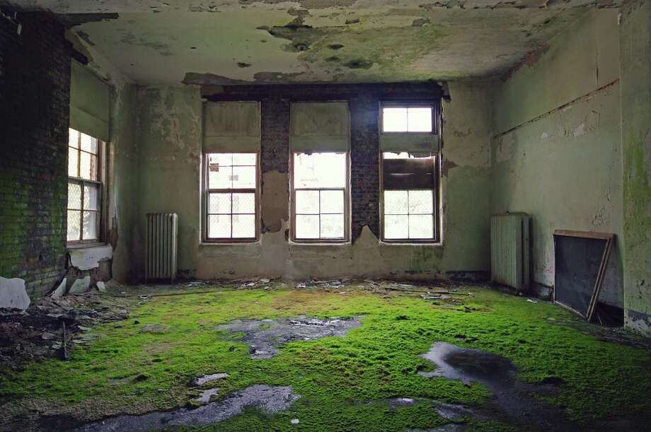 "Rusty Tagliareni and Christina Mathews have documented forgotten relics of the past in their newest book, ""Abandoned Asylums of the Northeast."" Photo: /"