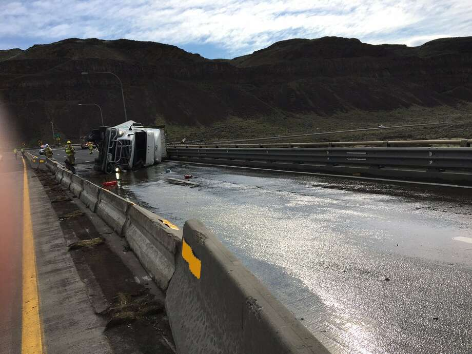 A semitractor-trailer rollover in Eastern Washington caused a four-lane closure of Interstate 90 on April 10. Cleanup lasted for several hours, causing eastbound lanes to be closed for several hours. Photo: Courtesy Of Washington State Patrol
