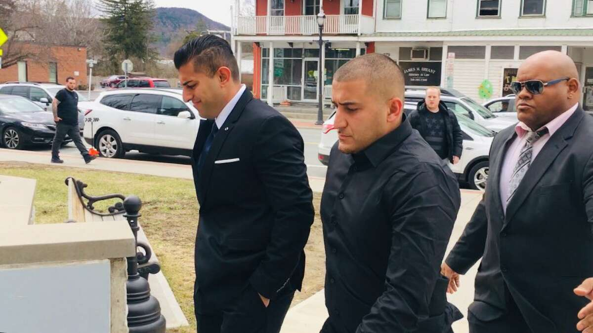 Nauman Hussain, left, arrives in Schoharie County Court with his brother on Wednesday, April 10, 2019, to be arraigned on 20 counts of criminally negligent homicide and 20 counts of second-degree manslaughter. Hussain is the operator of the limousine company involved in the Schoharie crash that killed 20. (Larry Rullison / Times Union)