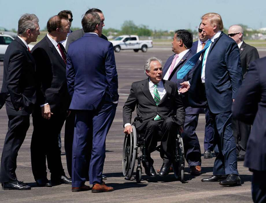 President Donald Trump is greeted by Texas Gov. Greg Abbott after arriving to Ellington Field, Wednesday, April 10, 2019 in Houston. He is scheduled to speak and sign executive orders on energy and infrastructure during his visit to the International Union of Operating Engineers (IUOE) International Training Center in Crosby. Photo: Melissa Phillip, Houston Chronicle / Houston Chronicle