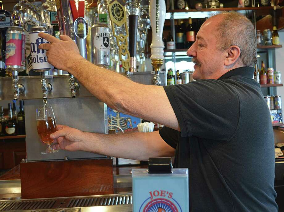 Joe Moon, a long-haul trucker and stage hand by trade, opened Joe's Filling Station restaurant and tap room in December at 35 Berlin Road/Route 372 in Cromwell. He offers appetizers, artisan sandwiches, charcuterie and cheese plates, all of which can be paired with various brews, wine or liquor. Photo: Cassandra Day / Hearst Connecticut Media