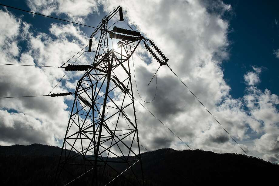 The Pacific Gas & Electric (PG&E) transmission tower, called Tower 27/222, which sparked the Camp Fire, in Pulga, Calif., Feb. 28, 2019. The fire began in November 2018 and destroyed the town of Paradise. The California utility left outdated towers in place and was slow to reduce hazards. Now it faces billions in liability claims over a series of blazes. (Max Whittaker/The New York Times) Photo: Max Whittaker / New York Times