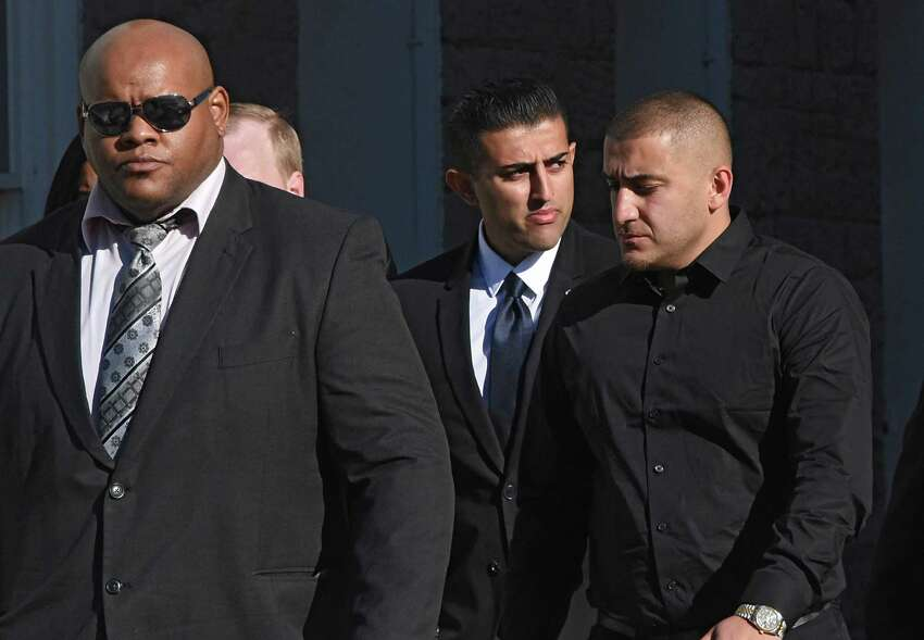 Nauman Hussain, the operator of Prestige Limousine, center, is surrounded by body guards as he leaves his arraignment at Schoharie County Court on Wednesday, April 10, 2019 in Schoharie, N.Y. Hussain had to post $450,000 bond and must wear a GPS. His brother Shahyer, who goes by Haris, is at right. (Lori Van Buren/Times Union)