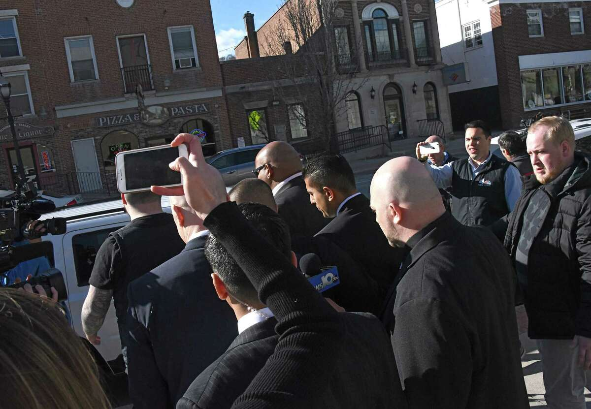 Nauman Hussain, the operator of Prestige Limousine, center, is surrounded by body guards as he leaves his arraignment at Schoharie County Court and gets into an SUV on Wednesday, April 10, 2019 in Schoharie, N.Y. Hussain had to post $450,000 bond and must wear a GPS. (Lori Van Buren/Times Union)