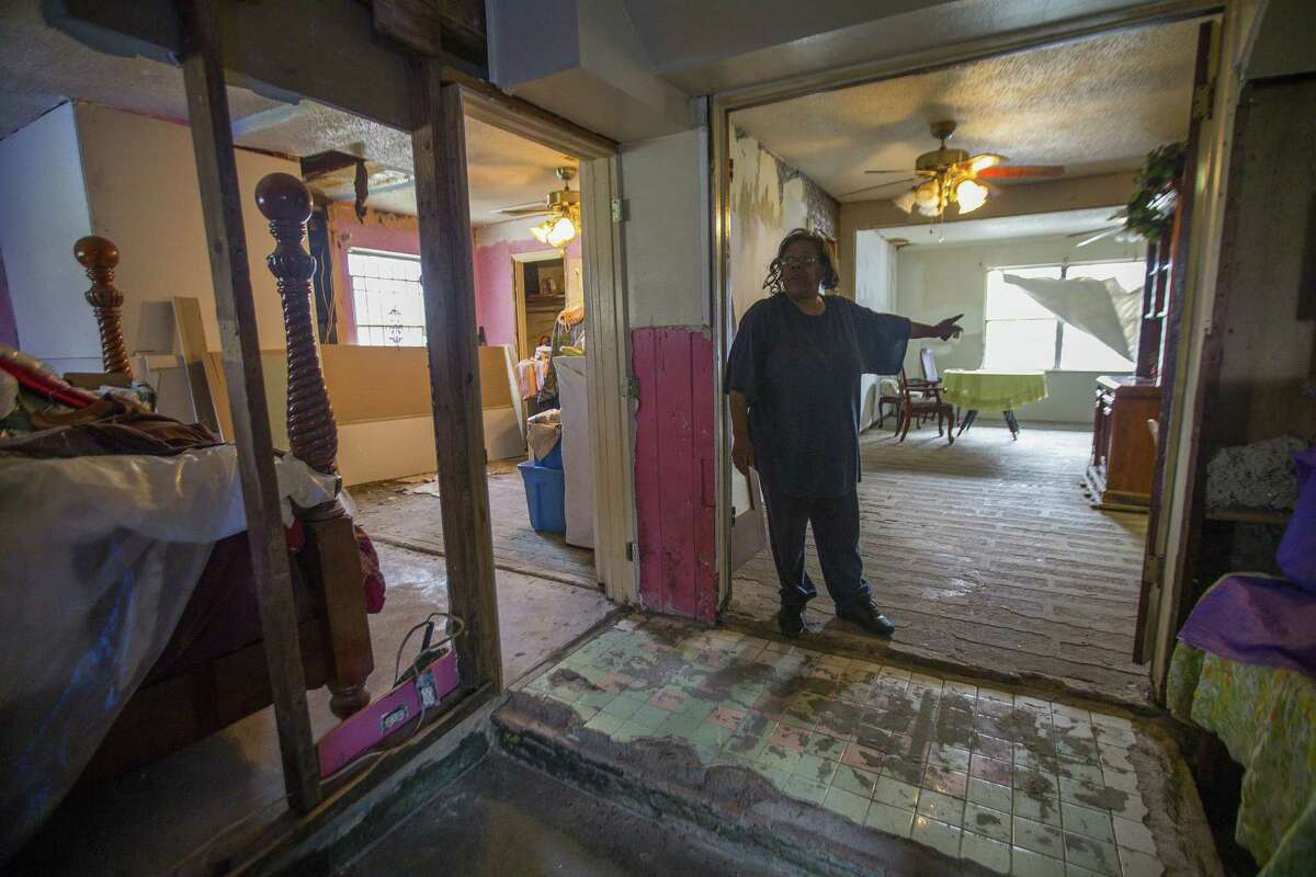 Annie Green stands in her Harvey-damaged home in northeast Houston, Tuesday, Jan. 15, 2019. Green has been working to find assistance completing repairs on the gutted house she lives in with her husband who suffers from Alzheimer's. She has had contractors begin work and disappear, even walking off with materials that were bought for her home.