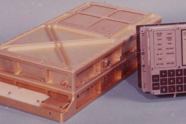 The DSKEY input module, right, shown alongside the Apollo Guidance Computer's main casing.