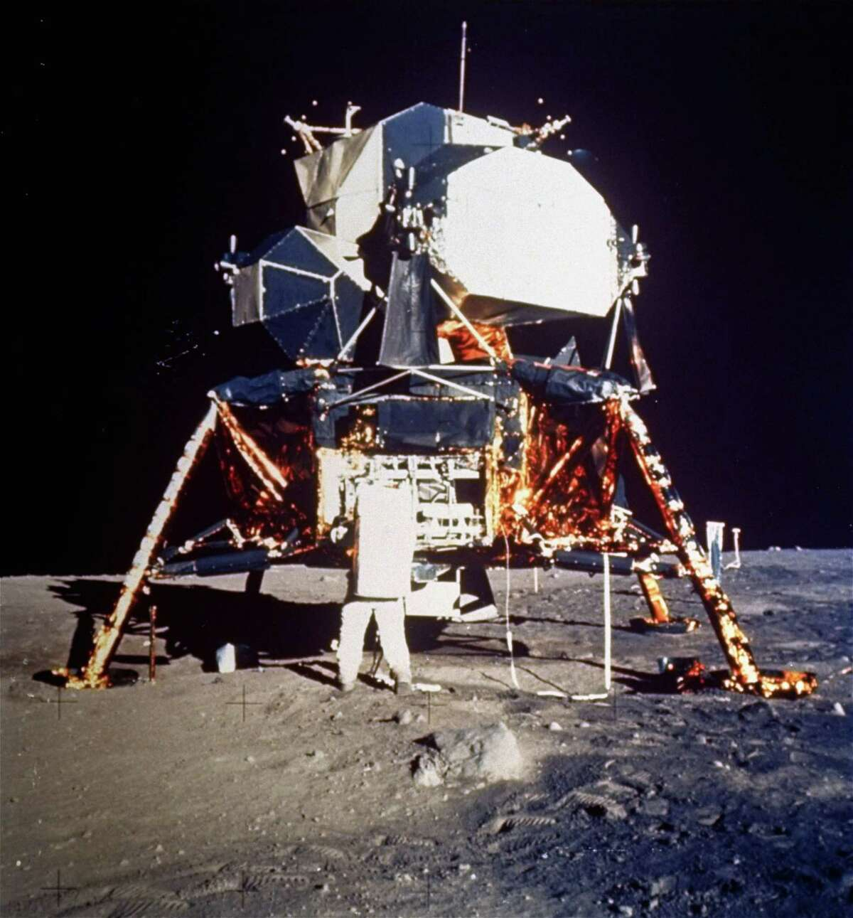 In this historic photo, Astronaut Buzz Aldrin prepares to deploy the Early Apollo Scientific Experiments Package (EASEP) during the Apollo II lunar surface extravehicular activity on July 20, 1969. Astronaut Neil A. Armstrong took the photograph with a 70mm lunar surface camera.