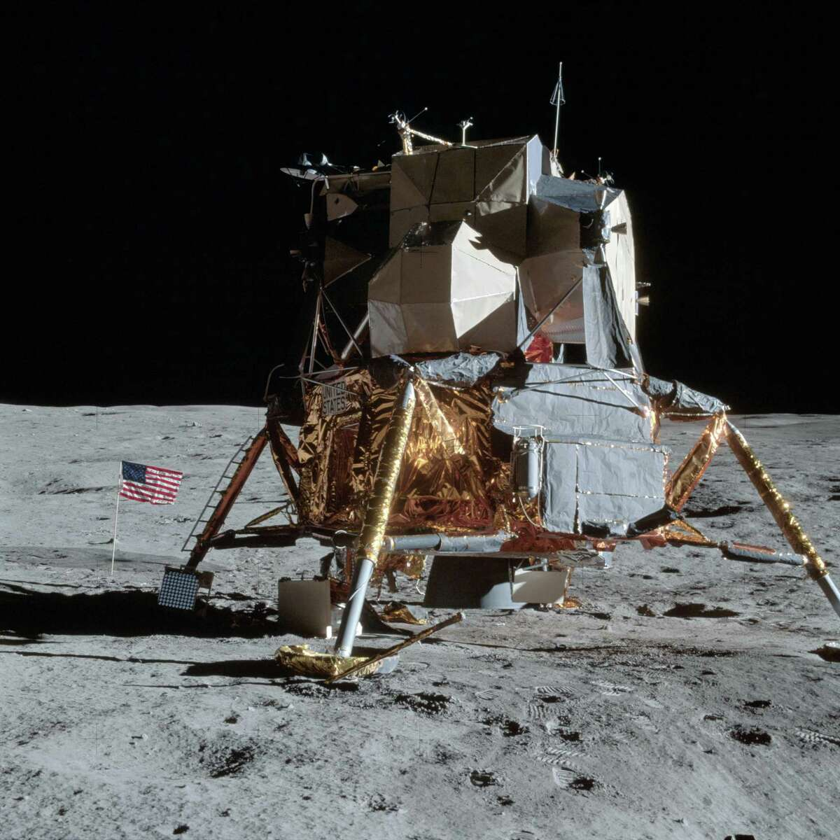 A view of the Apollo 14 Lunar Module on the moon as photographed on Feb. 5, 1971 during the first Apollo 14 extravehicular activity on the lunar surface. The astronauts have already deployed the U.S. flag. Astronauts Alan B. Shepard Jr. and Edgar D. Mitchell descended in the lunar module to explore the moon while Astronaut Stuart A. Roosa remained in orbit with the Command and Service Modules.