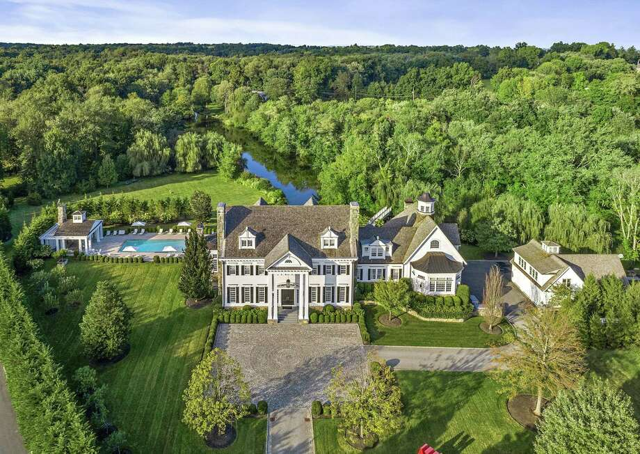 Music executive Tommy Mottola has sold his home at 33 John St., in backcountry Greenwich, Conn., for about $14.9 million. Photo: Contributed Photo