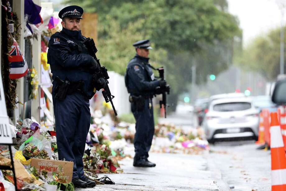 Armed police officers stand guard April 5 outside the Al Noor mosque, one of the mosques where some 50 people were killed by a self-avowed white supremacist gunman on March 15, in Christchurch. A reader applauds New Zealand for its resilience and strength. Photo: SANKA VIDANAGAMA /AFP /Getty Images / AFP or licensors