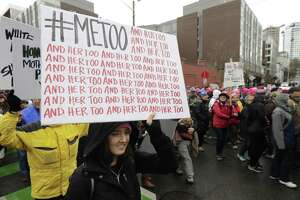 A marcher carries a sign with the Twitter hashtag #MeToo used by people speaking out against sexual harassment as she takes part in a Women's March in Seattle, on the anniversary of President Donald Trump's inauguration in January. The #MeToo movement is an example of norm-busting — rebelling against the norm among a male subset that allowed inappropriate touching and passed it off as something else.