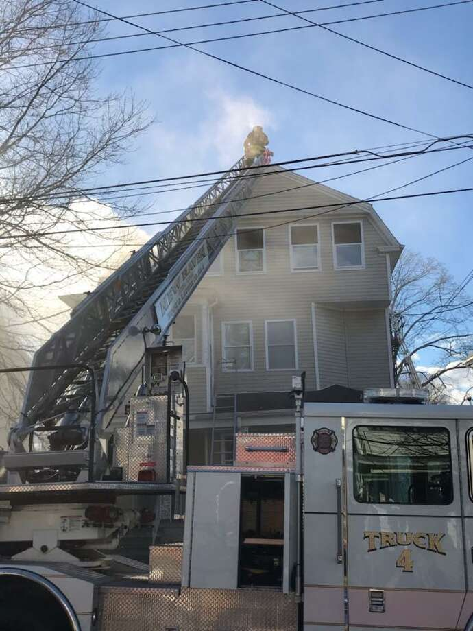 Firefighters battle a blaze at 349 Sherman Ave. in New Haven Wednesday. No one was injured but at least 6 people were displaced. Photo: Contributed Photo